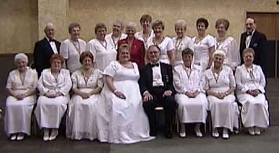 (Picture taken on December 11, 2004 - Past Grand Officers did Initiation) Seated Left to Right: Louella C. Coons, ; Carla K. Thompson ; Evelyn Kostenbauder, ; Rhonda M. Johnson, WGM; Clyde C. Stine, WGP; Ann K. Berger; Betty L. MacAdam; Shirley J. Markle, Second Row: L. Wayne Miller, ; Elizabeth Hammell; Jo-Anne G. Karnes; Andrea T. Love; Judy A. Rutter, Beverly J. Small; Barbara E. Adams; Jean D. Fey; Carol J. Stine, Grand Marshal; Arlene S. Flohr; Peter Brusamonti